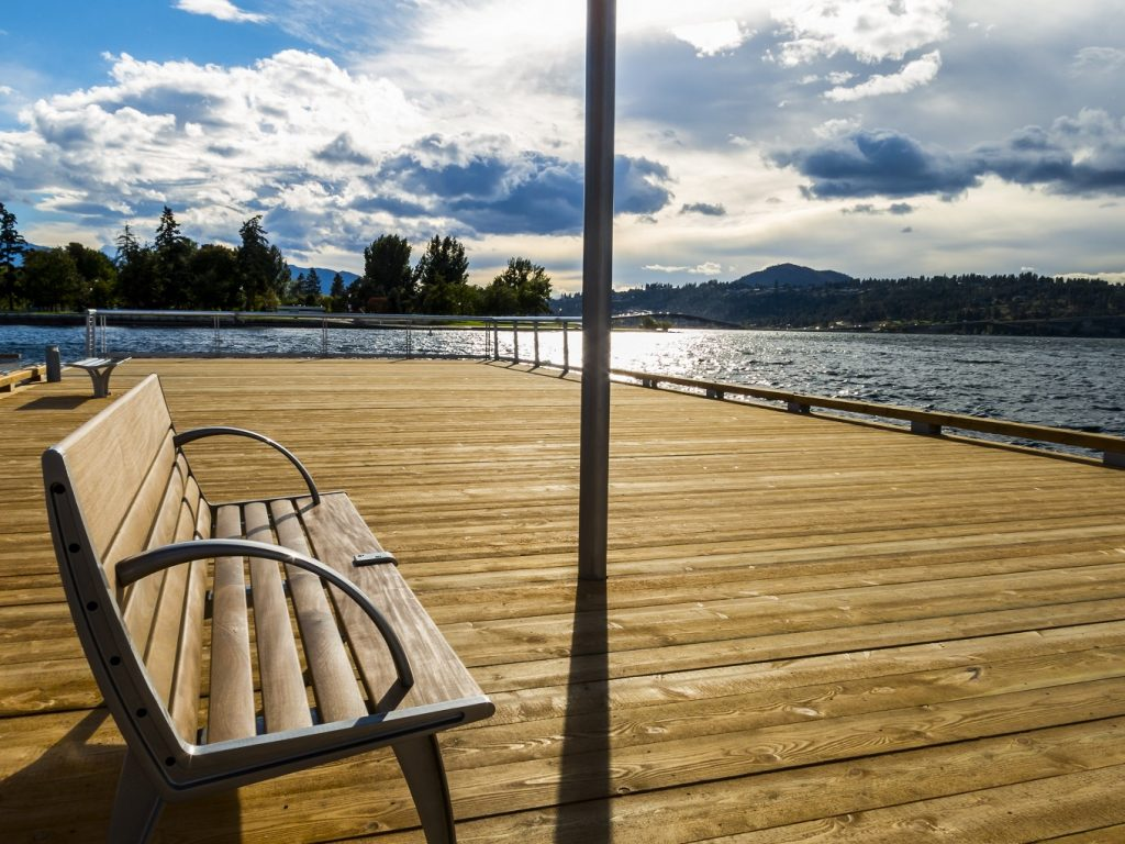 bench on boardwalk by Okanagan lake real estate in Kelowna