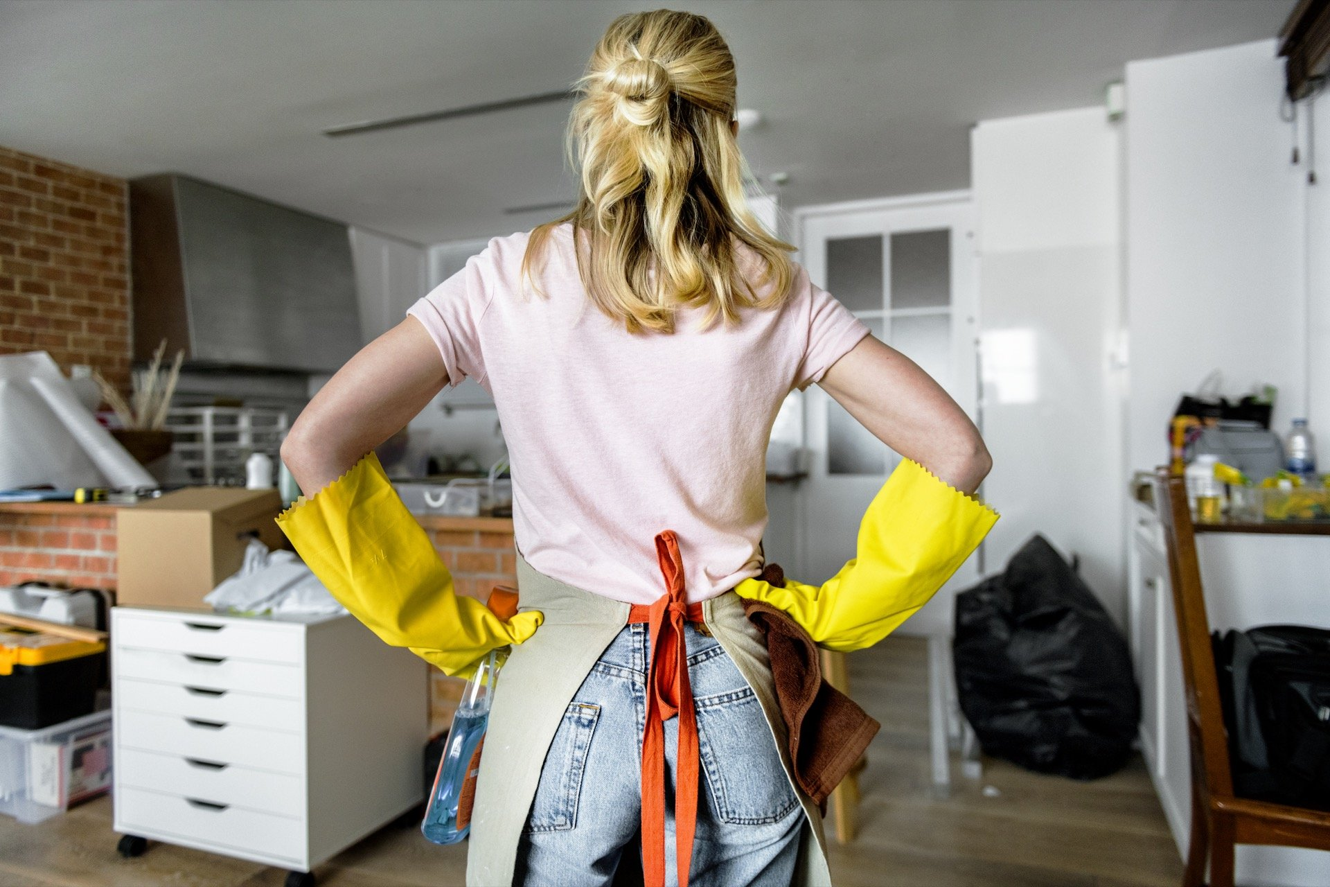 woman cleaning up home to sell