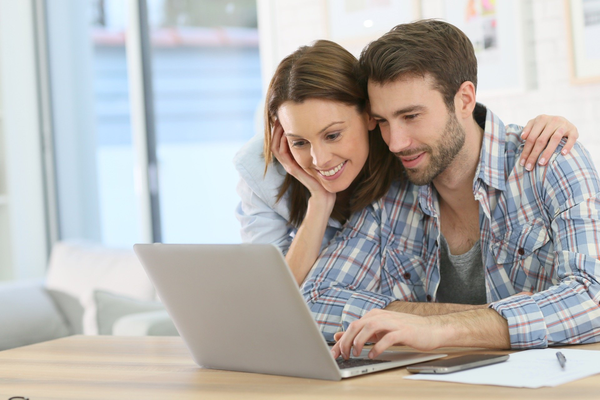 Couple researching homes to invest in