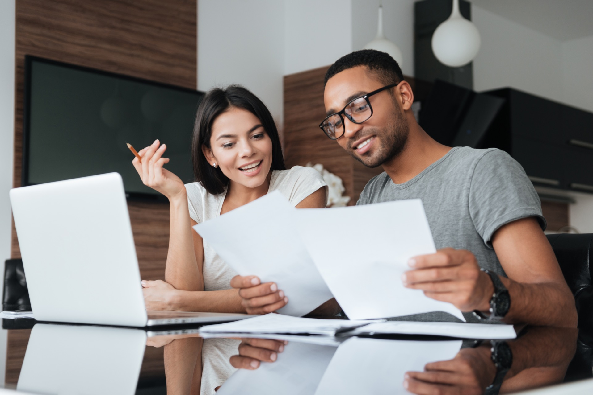 Young couple reviewing finances for new house