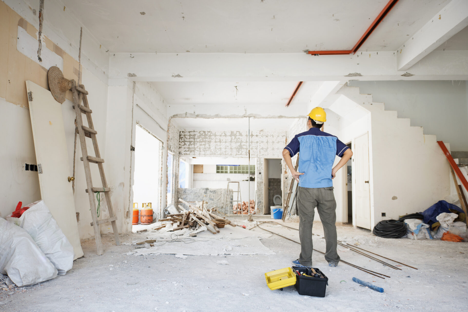 Construction man renovating fixer upper in Kelowna