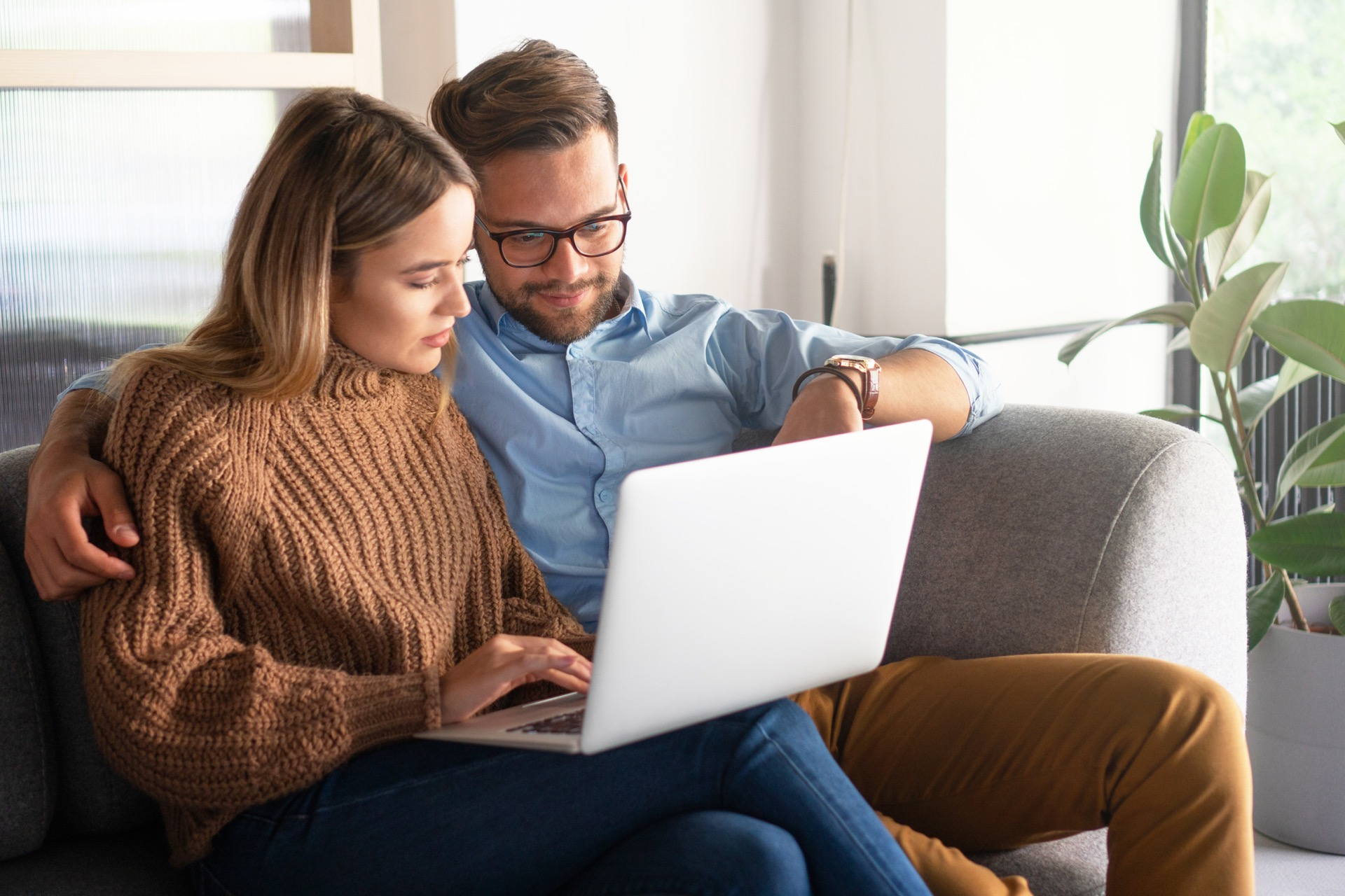 Happy couple looking at real estate agents in Kelowna online
